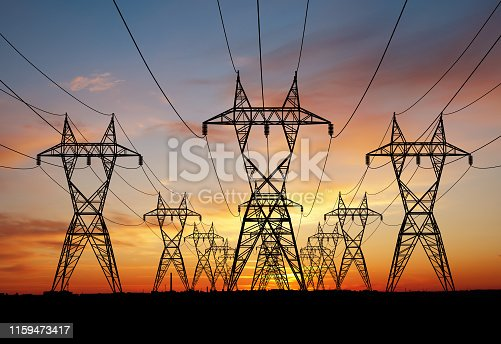 A three row power lines over sunset background