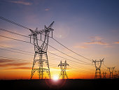 Electricity power pylons over sunset
