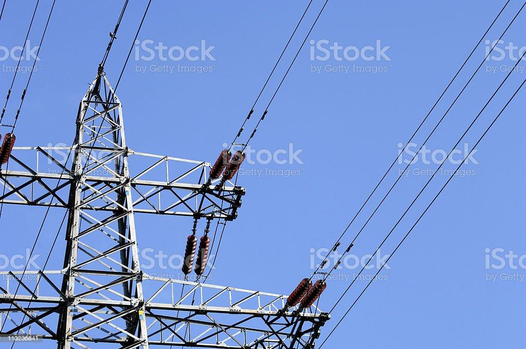 Electricity pylon against blue sky royalty-free stock photo