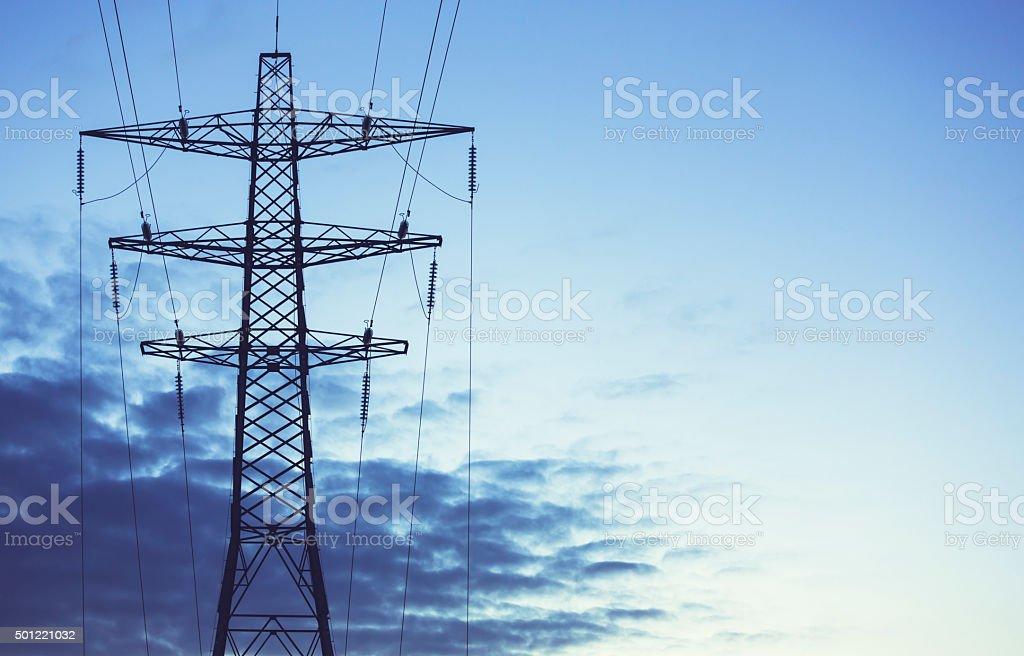 Electricity Pylon against blue sky - UK stock photo