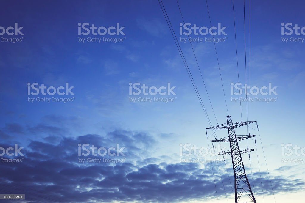Electricity Pylon against blue sky - UK stock photo