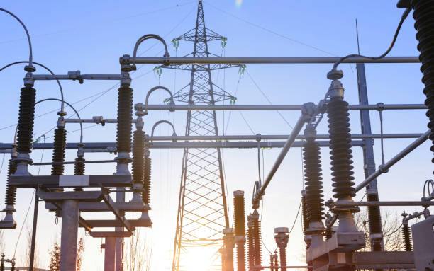Electricity pylon and power lines in distribution electricity substation Power station on a sunset, close up of a high voltage transformer in power substation. electricity transformer stock pictures, royalty-free photos & images