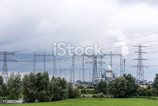 Global warming source Electricity Pylon around obsolete coal powered power station