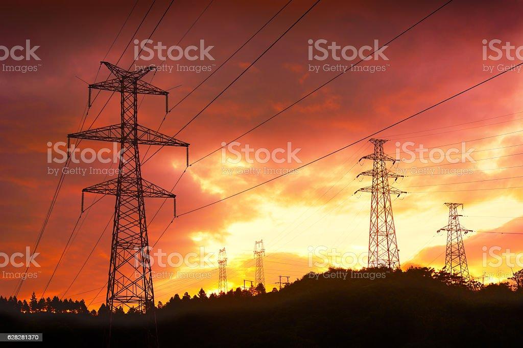 Electricity pylon at sunset stock photo