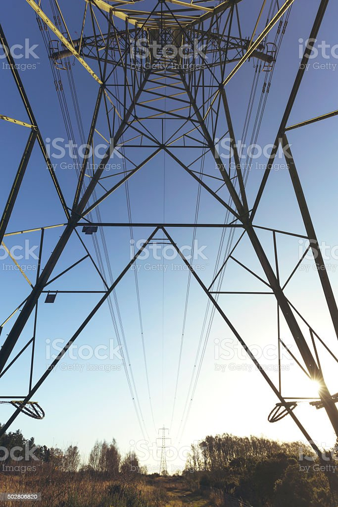 Electricity Pylon at sunset - UK stock photo