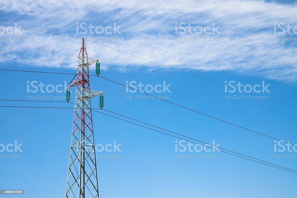 Electricity pylon on blue background stock photo