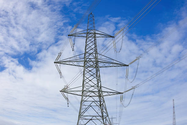 Electricity pylon on Uk countryside.Blue sky with clouds in background.Energy production and transportation.British Northern powerhouse. stock photo