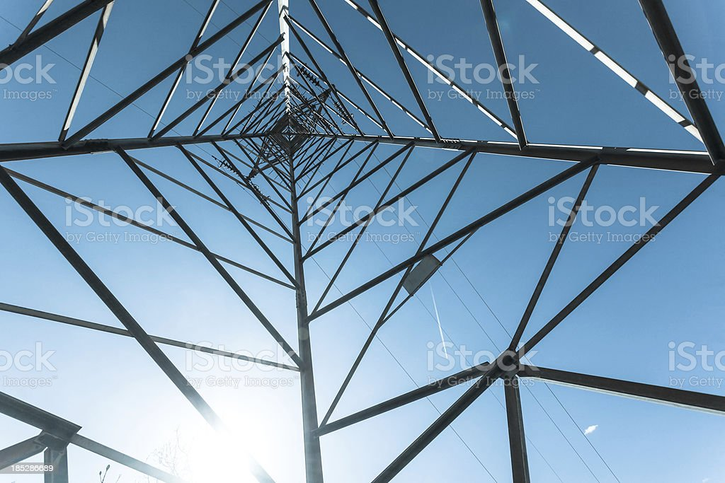 Electricity Pylon Structure against a Blue Sky royalty-free stock photo