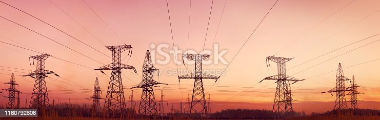 Silhouette electricity pylons at sunset. This image created from multiple images (5) for the best quality.