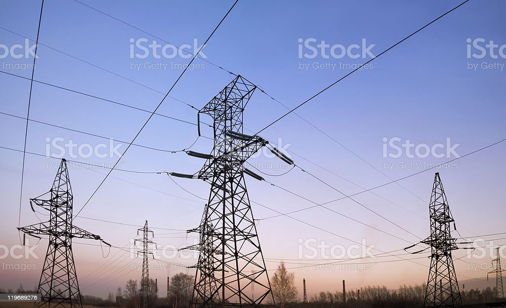 Electricity pylons and lines at dusk. royalty-free stock photo