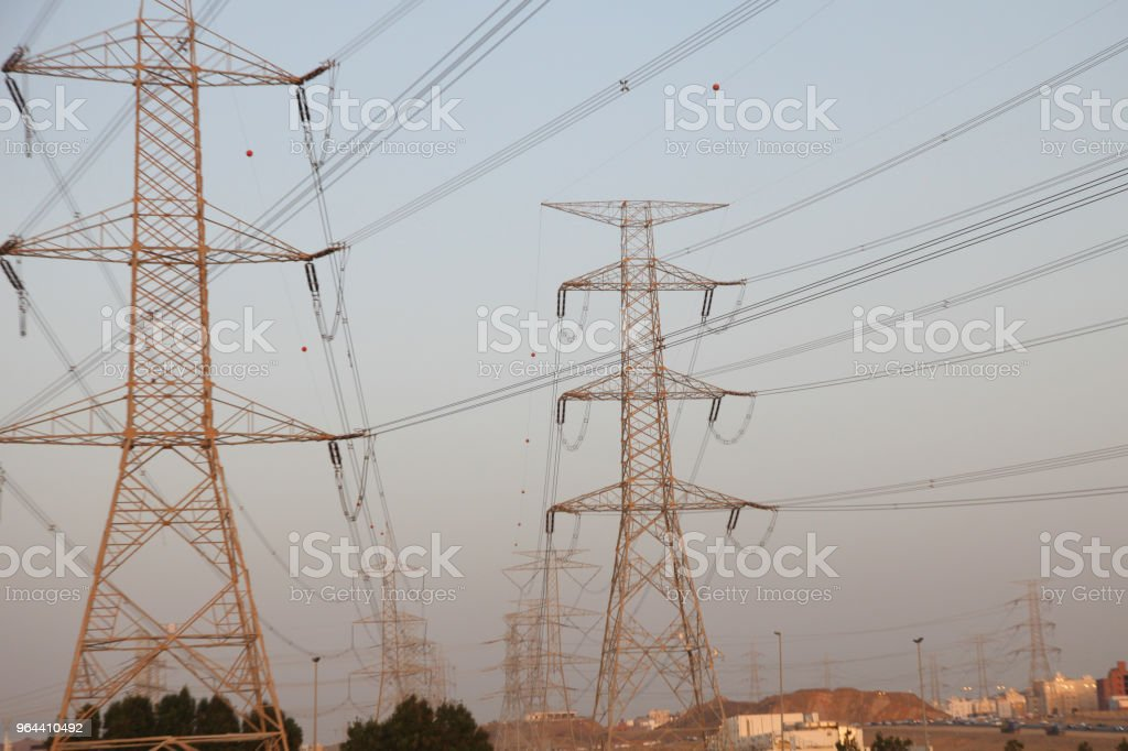 Electricity pylons and power lines, at sunset - Royalty-free Architectural Column Stock Photo