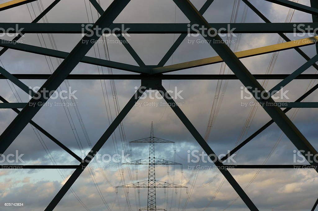 electricity pylons in a row stock photo