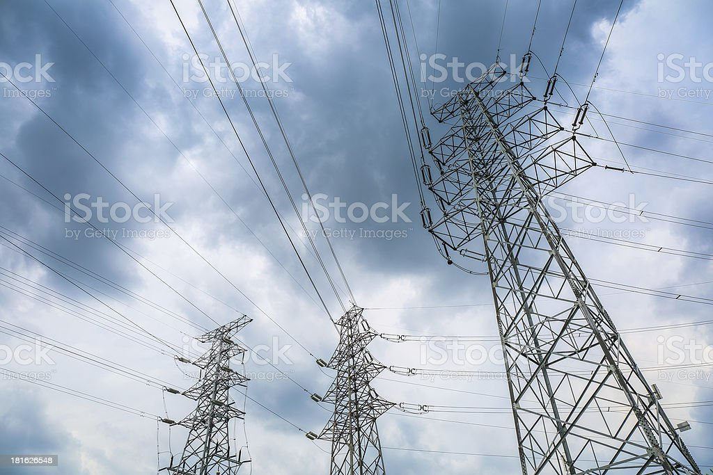 electricity pylons in cloudy stock photo