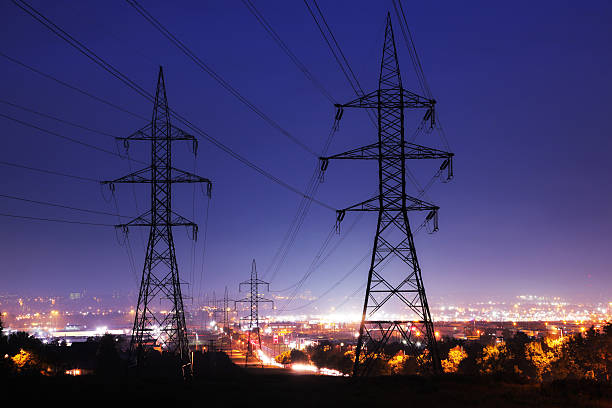electricity pylons in illuminated quebec city - hoogspanningsmast stockfoto's en -beelden