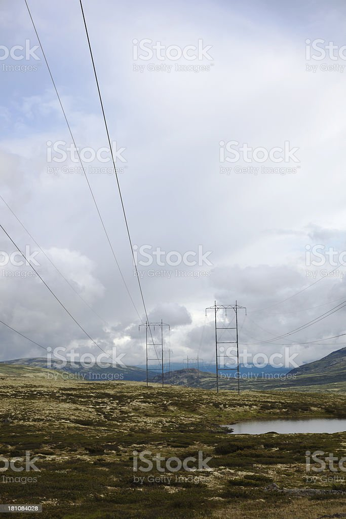 Electricity pylons in the mountains. royalty-free stock photo
