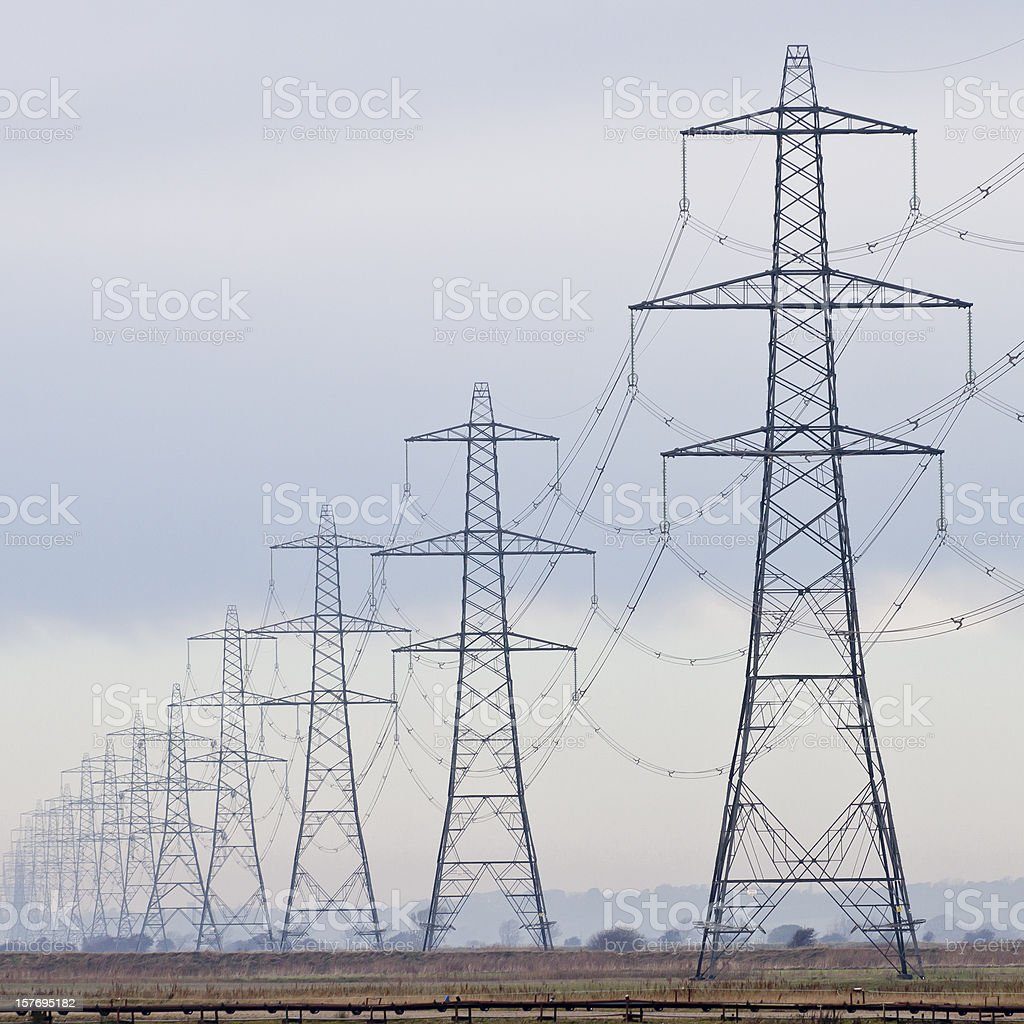 Electricity pylons / power lines stock photo