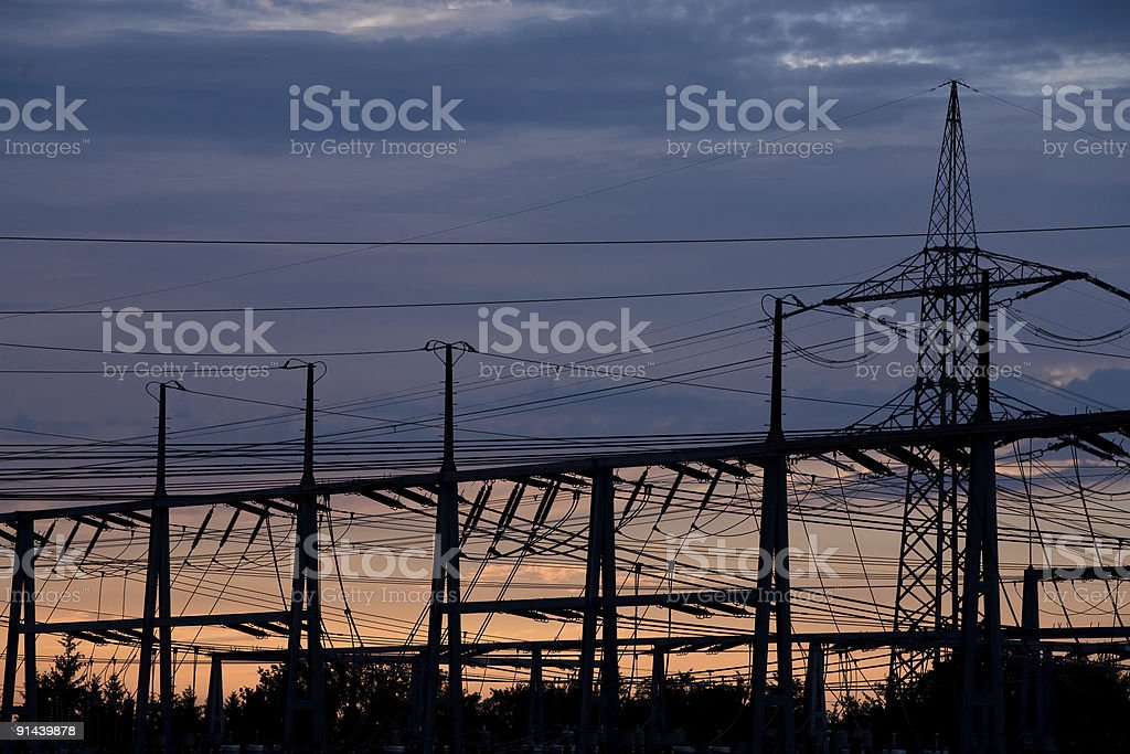 Electricity pylons silhouettes at dawn. royalty-free stock photo