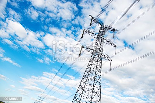 Electricity pylons under the blue sky