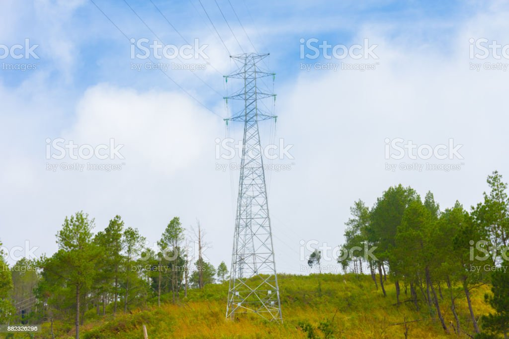 Electricity station. Close up high voltage power lines at mountain outdoor landscape. stock photo
