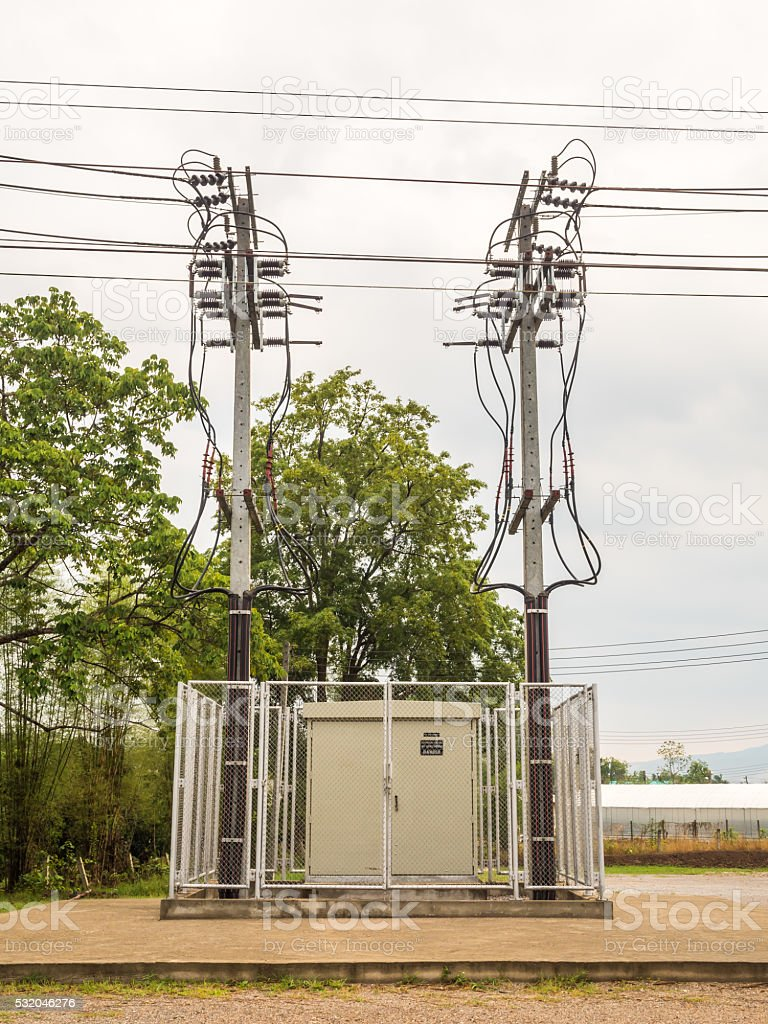 Electricity Substation and Twin High Voltage Pole stock photo