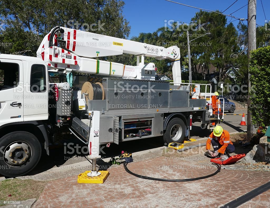 Electricity supply workers stock photo