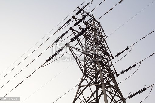istock electricity tower overhead power line transmission tower on background blue sky. 984177772