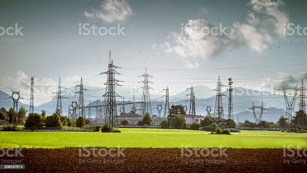 electricity towers and high voltage lines in a nice landscape stock photo