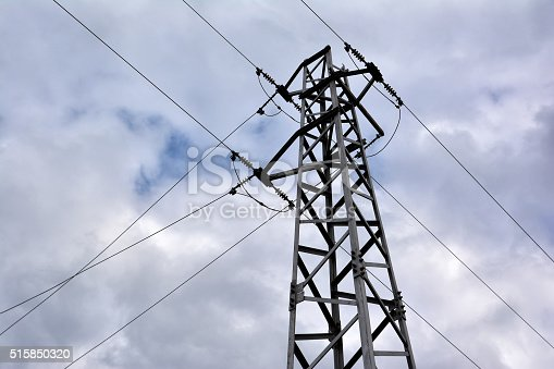 600401714istockphoto Electricity transmission pylon against cloudy sky 515850320
