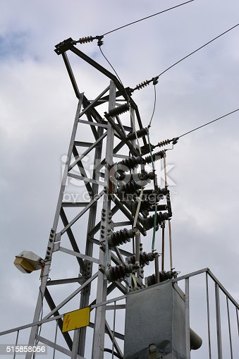600401714istockphoto Electricity transmission pylon against cloudy sky 515858056