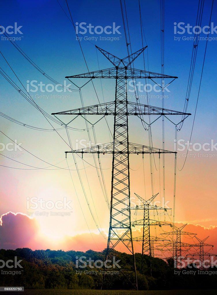 electricity transmission pylon at sun set stock photo