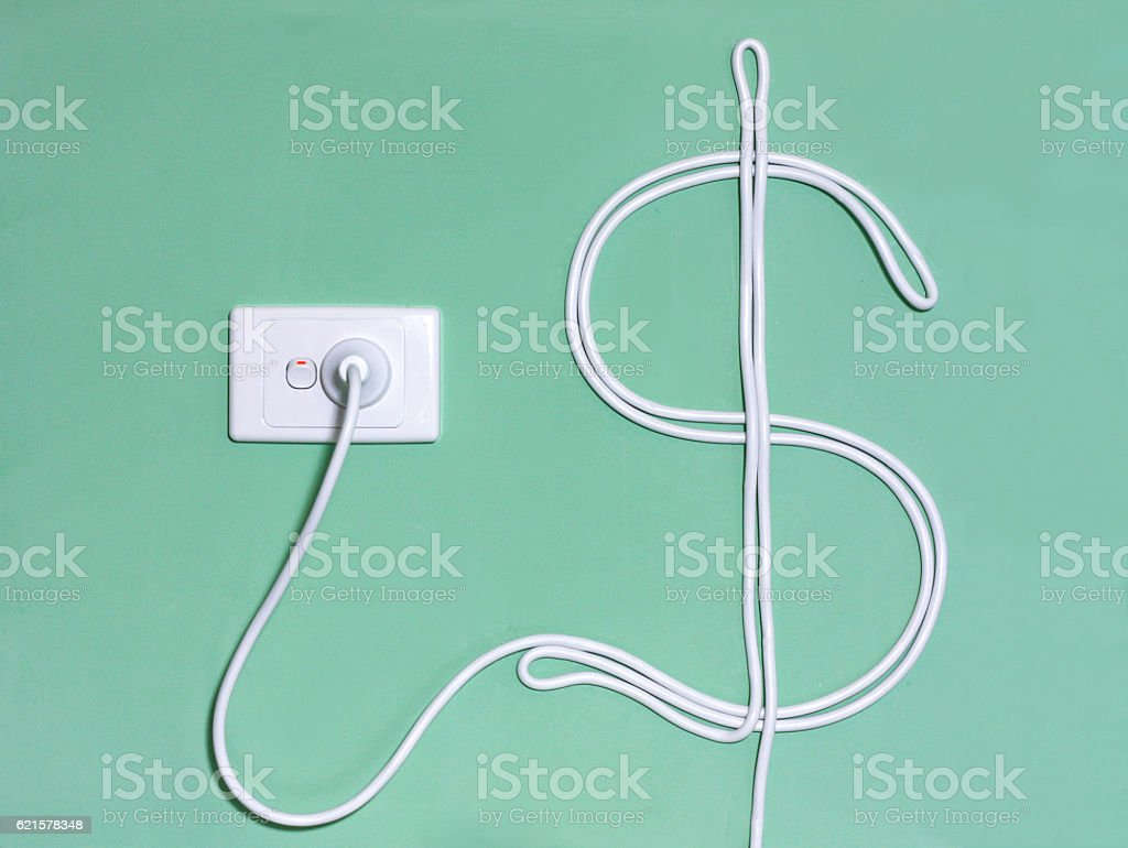 Electricity wall socket and power cord in the dollar sign stock photo