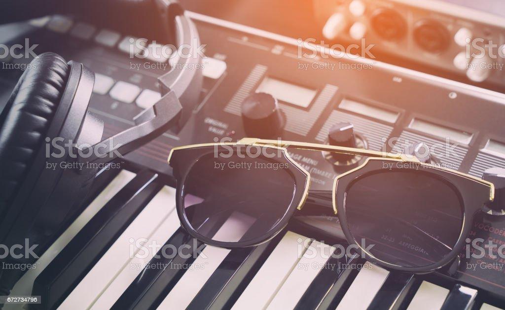 Electro Fashion sunglasses in dance music studio stock photo