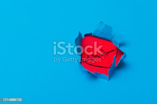 istock Electrocardiogram and heart sign in paper cut hole. Blue background 1214688725