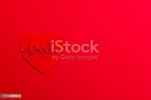 istock Electrocardiogram and heart sign on background 1214688633