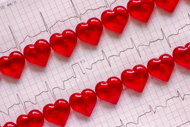Electrocardiogram and red hearts. stock photo