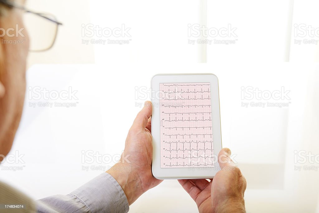 Electrocardiogram on Digital Tablet royalty-free stock photo