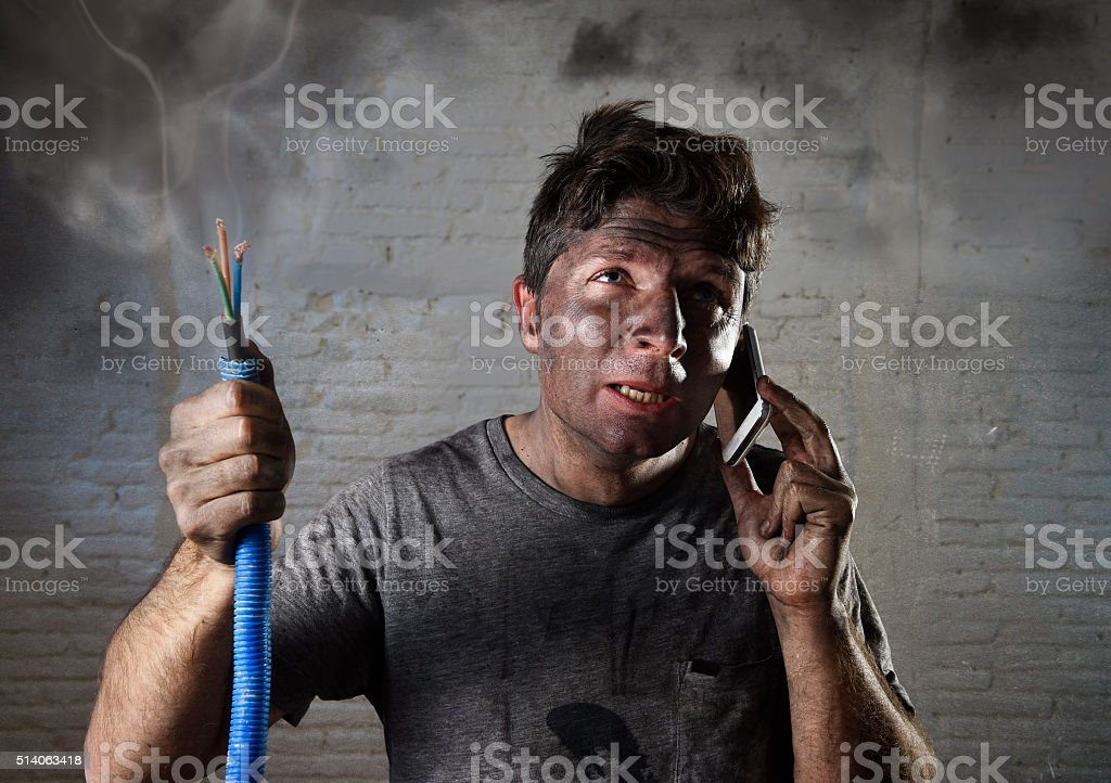 electrocuted man calling for help in dirty burnt funny face stock photo