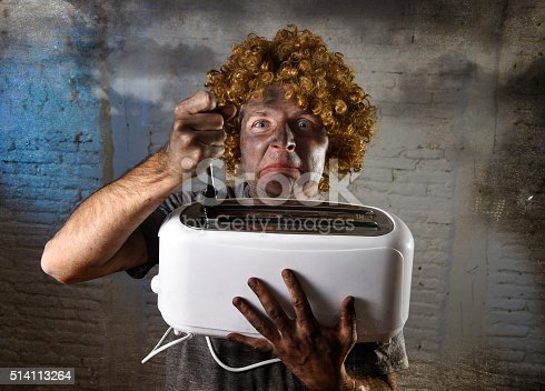 istock electrocuted trying to get toast out of toaster with knife 514113264