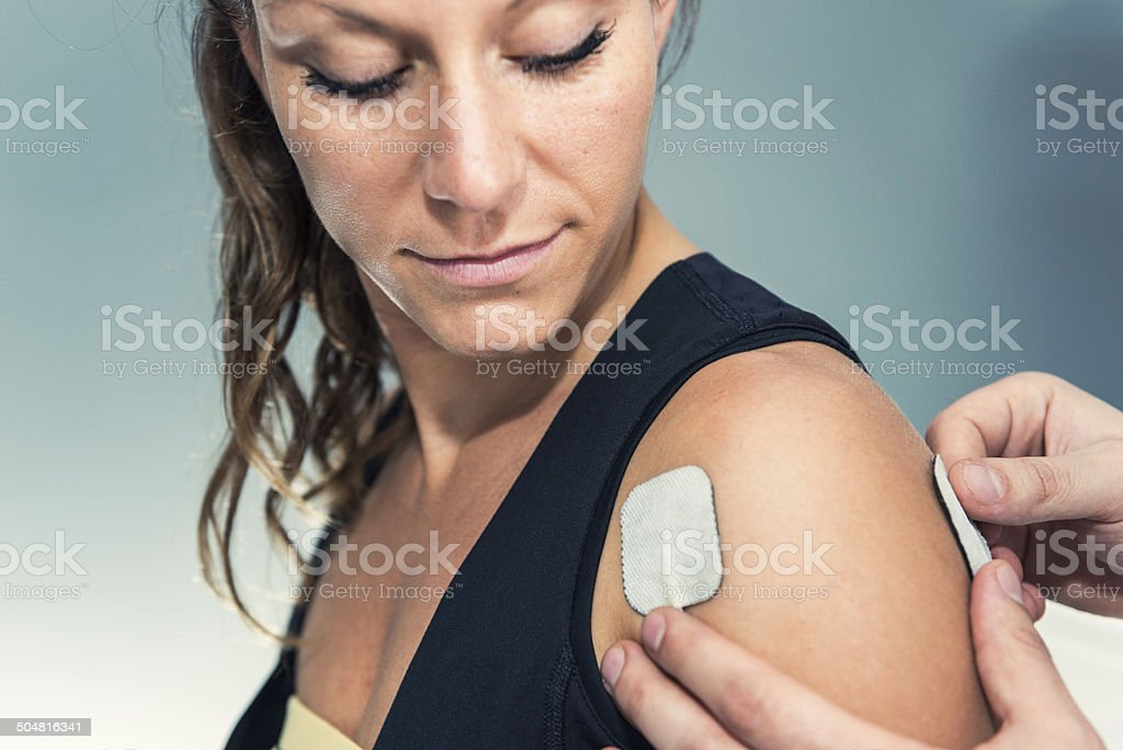 Electrodes of tens device on human shoulder stock photo