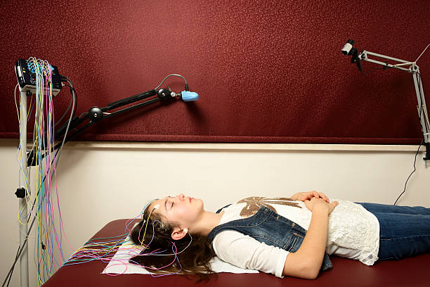 Electroencephalography Actual Electroencephalography (EEG) recording net being used on a young girl. EEG is the recording of the brain's spontaneous electrical activity over a short period of time. neuroscience patient stock pictures, royalty-free photos & images