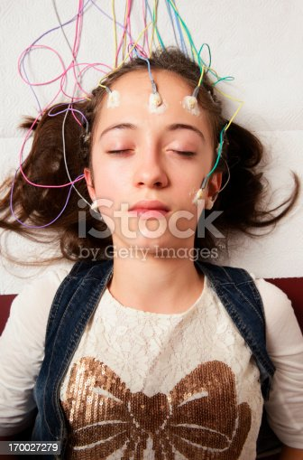 Actual Electroencephalography (EEG) recording net being used on a young girl. EEG is the recording of the brain's spontaneous electrical activity over a short period of time.