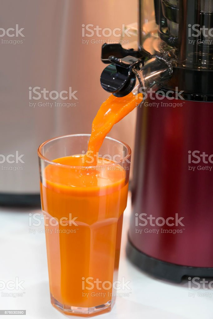 Electrojuice extractor for fruit and vegetables stock photo