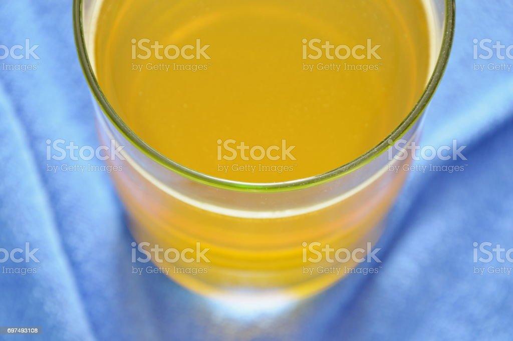 electrolyte orange flavor powder dissolution in freshwater stock photo