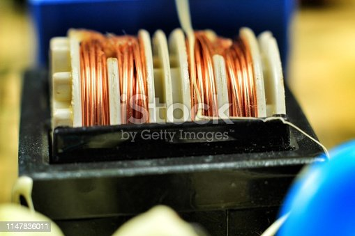 istock Electromagnetic coil on a motherboard 1147836011
