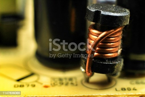istock Electromagnetic coil on a motherboard 1147836065