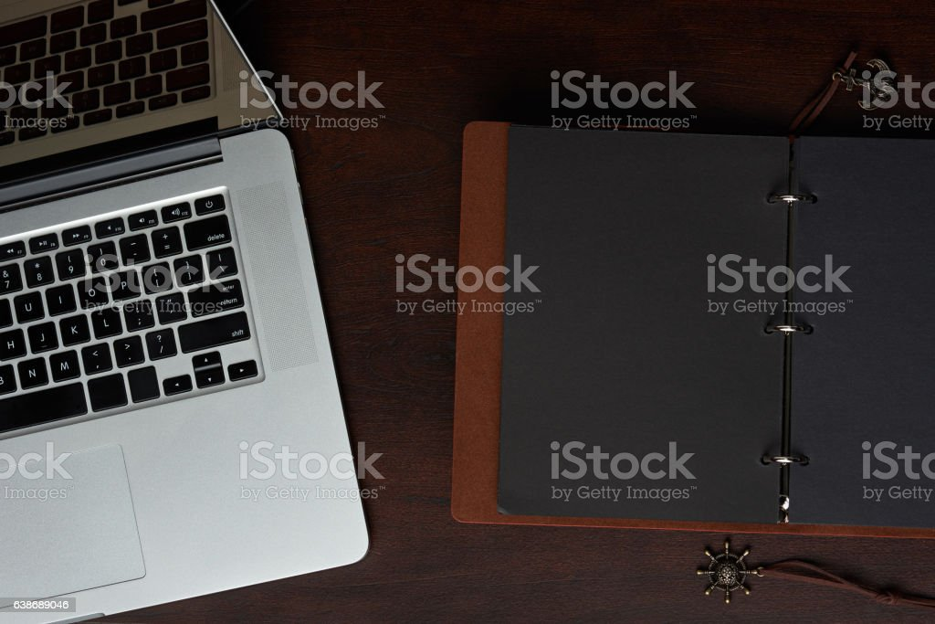 Electronic and paper journal book stock photo