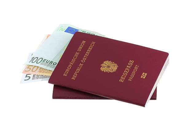 Electronic Austrian passports with 5, 50, 100 Euro Banknotes stock photo