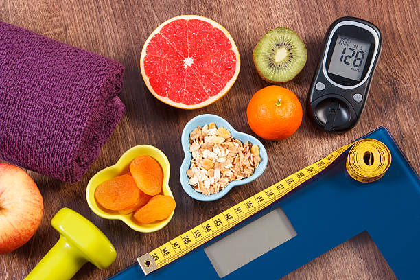 Electronic bathroom scale, glucometer, centimeter, healthy food stock photo