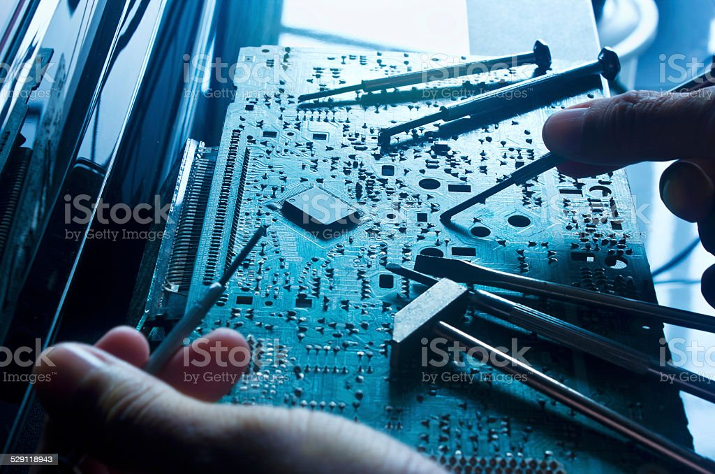 Electronic board and tools repairs, toned blue concept stock photo