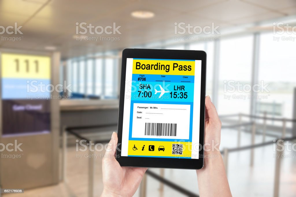 Electronic Boarding Pass on your Tablet. Concept of modern travel. stock photo
